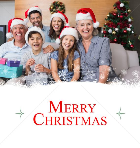 Afbeelding uitgebreide familie christmas hoeden geschenk Stockfoto © wavebreak_media