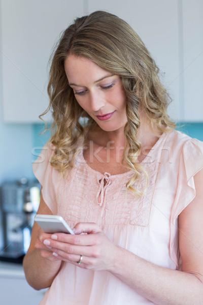 Pretty blonde on the phone Stock photo © wavebreak_media