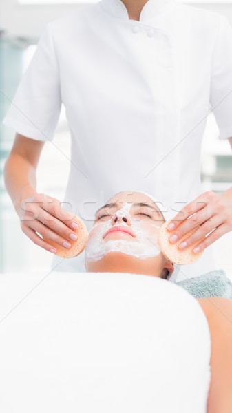 Hands cleaning woman face with sponge Stock photo © wavebreak_media