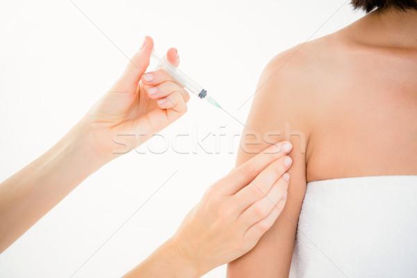 Woman receiving injection on arm  Stock photo © wavebreak_media