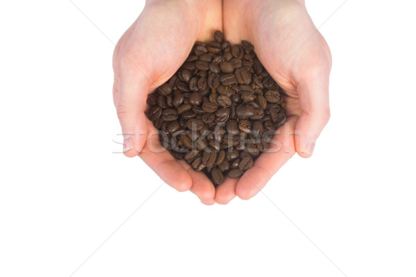 Close up view of hands showing coffee beans Stock photo © wavebreak_media