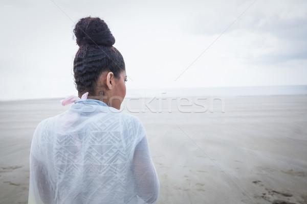 Stylish woman looking out to sea Stock photo © wavebreak_media