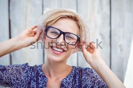 Composite image of gorgeous blonde hipster winking Stock photo © wavebreak_media