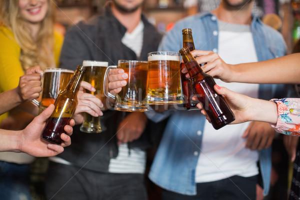 Amigos cerveja óculos garrafas pub Foto stock © wavebreak_media
