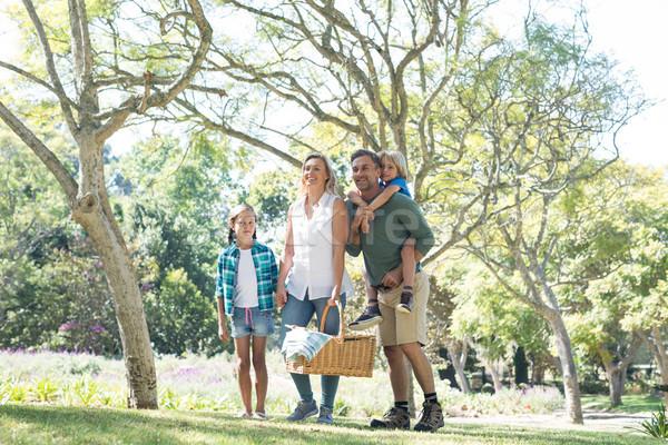 Family arriving in the park for picnic Stock photo © wavebreak_media
