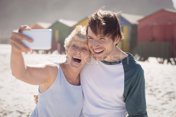 Cheerful woman with son taking selfie at beach Stock photo © wavebreak_media