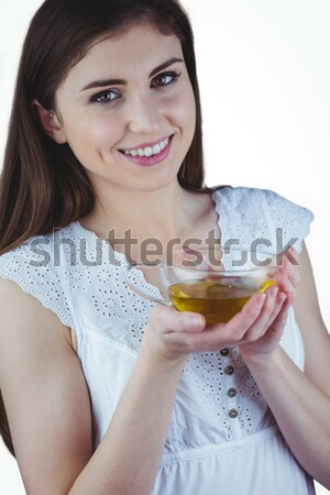 Close up portrait of smiling woman pouring cream on palm Stock photo © wavebreak_media
