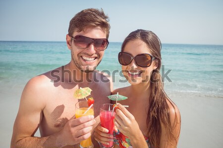 Portrait heureux couple boissons plage Photo stock © wavebreak_media