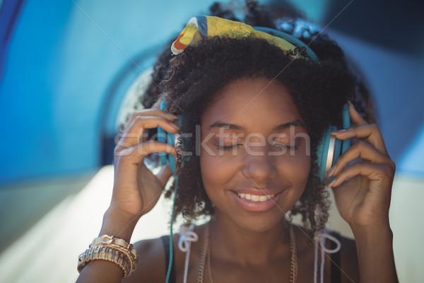 Close up of woman listening music Stock photo © wavebreak_media
