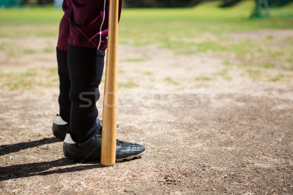 Low section of baseball player holding bat while standing on field Stock photo © wavebreak_media