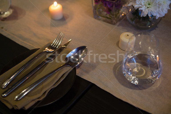 High angle view of cutlery and candles on table Stock photo © wavebreak_media