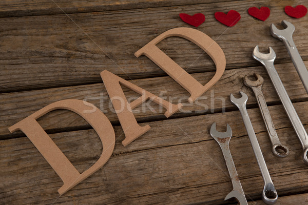 Dad text by wrenches with heart shapes on table Stock photo © wavebreak_media