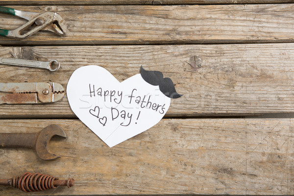 Stock photo: Overhead view of happy fathers day text by work tools