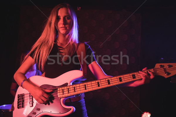 Young female guitarist performing in nightclub Stock photo © wavebreak_media