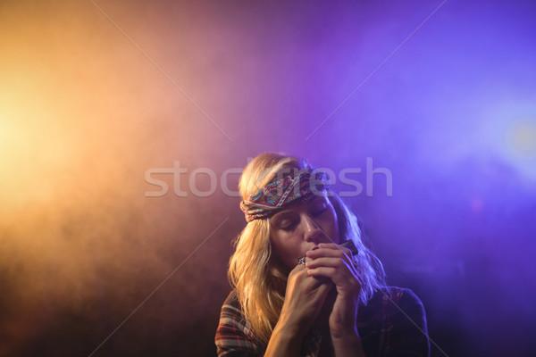 Female musician playing harmonica in nightclub Stock photo © wavebreak_media