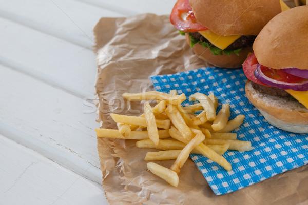 гамбургер картофель фри деревянный стол продовольствие вечеринка Сток-фото © wavebreak_media