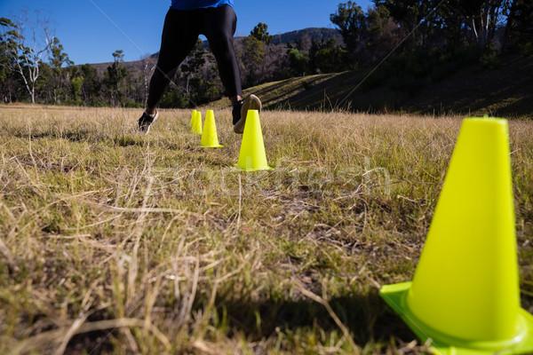 Donna esecuzione formazione erba fitness Foto d'archivio © wavebreak_media