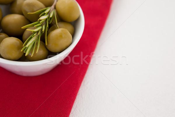 Cropped image of olives in bowl on napkin Stock photo © wavebreak_media