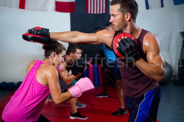 Female boxer defending with instructor Stock photo © wavebreak_media
