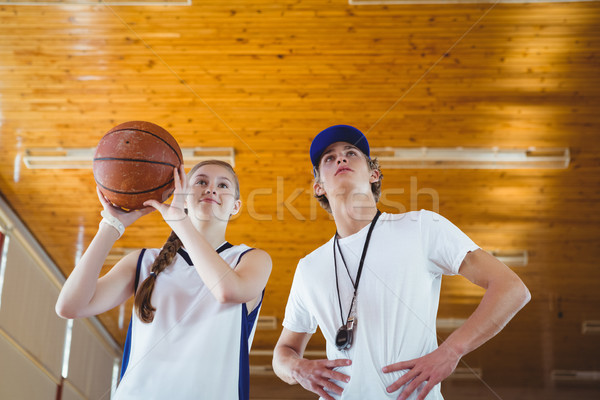 Low angle view of male coach advising female basketball player Stock photo © wavebreak_media