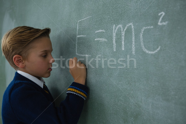 Iskolás fiú ír matematika képlet tábla imádnivaló Stock fotó © wavebreak_media