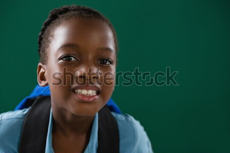 School girl with backpack standing against chalk board Stock photo © wavebreak_media