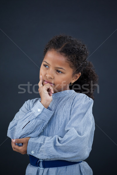 девушки стороны подбородок Постоянный черный Сток-фото © wavebreak_media