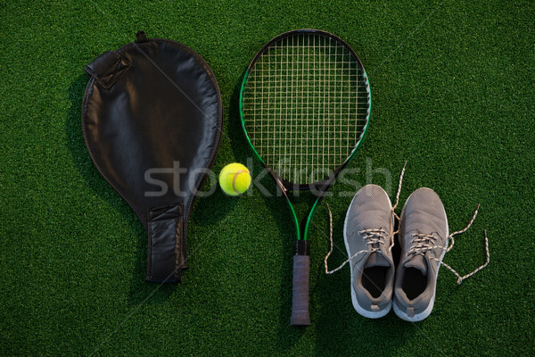 Directly above shot of racket with ball and sports shoes Stock photo © wavebreak_media