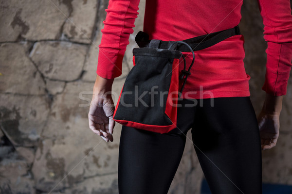Mid section of woman standing with fanny pack Stock photo © wavebreak_media