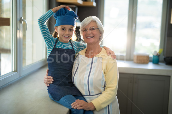 Grandmother and granddaughter posing by embracing each other Stock photo © wavebreak_media