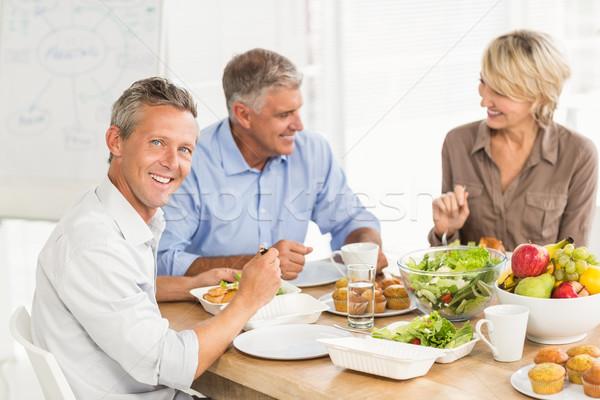 Sorridente negócio colegas almoço juntos retrato Foto stock © wavebreak_media