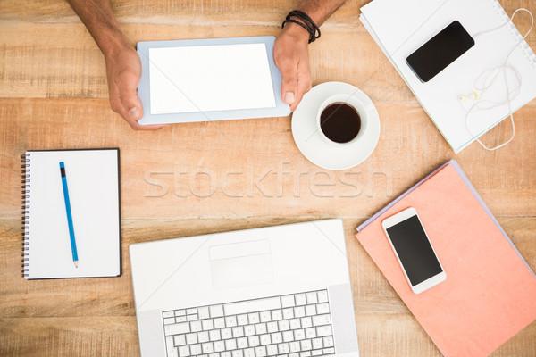 Mani tablet parecchi legno Foto d'archivio © wavebreak_media
