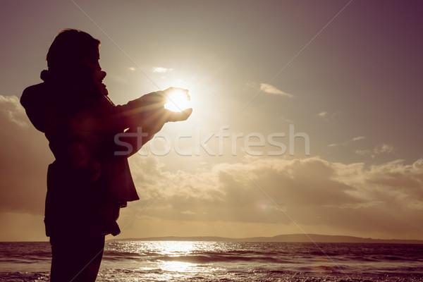 Woman holding the light of the sun  Stock photo © wavebreak_media
