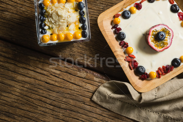 Various fruit cereals on a wooden table Stock photo © wavebreak_media