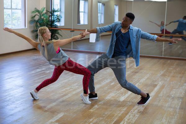 Full length of dancers rehearsing against mirror on wooden floor Stock photo © wavebreak_media