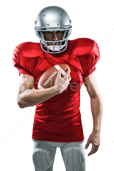 Portrait of confident American football player in red jersey hol Stock photo © wavebreak_media