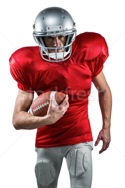 Portrait of American football player in red jersey running with  Stock photo © wavebreak_media