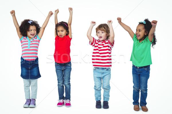Négy gyerekek áll karok a magasban levegő fehér Stock fotó © wavebreak_media
