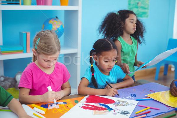 счастливым дети рисунок фотографий столе Сток-фото © wavebreak_media