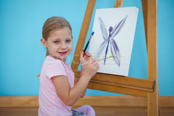Smiling girl beside her picture Stock photo © wavebreak_media