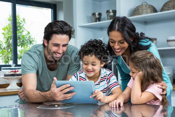 Happy family using tablet in kitchen Stock photo © wavebreak_media