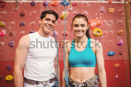 Portrait of confident athletes against climbing wall in gym Stock photo © wavebreak_media