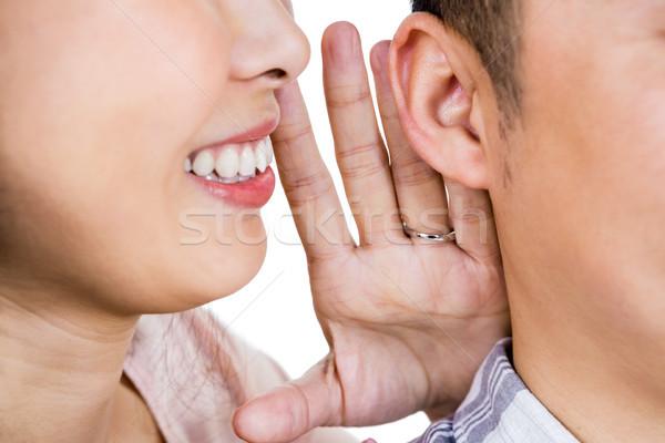 Cropped image of woman whispering secret to husband  Stock photo © wavebreak_media