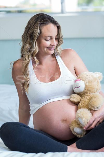 妊婦 座って テディベア ベッド 女性 幸せ ストックフォト © wavebreak_media