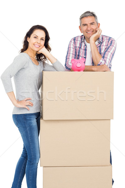 Couple with boxes and piggy bank Stock photo © wavebreak_media