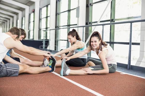 четыре спортивный женщины мужчин работает Сток-фото © wavebreak_media