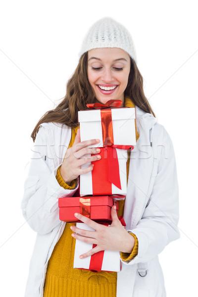Csinos barna hajú tart néhány ajándékok fehér Stock fotó © wavebreak_media