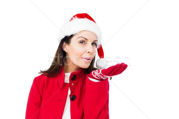 Beautiful brunette with santa hat blowing kiss Stock photo © wavebreak_media
