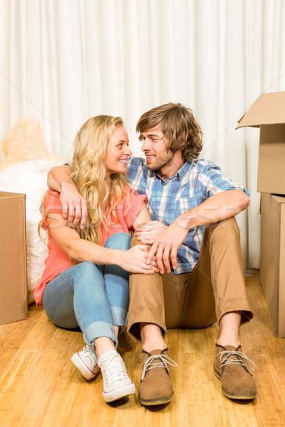 Happy couple sitting on the floor  Stock photo © wavebreak_media