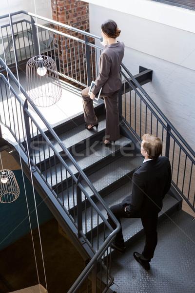 Businesspeople climbing the staircase Stock photo © wavebreak_media